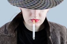 portrait of a smoking woman with red lips