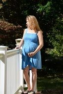 Pretty pregnant woman in blue dress