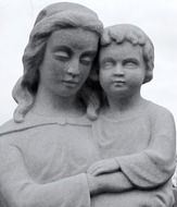 sculpture of a woman with a child