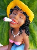female porcelain figure smoking marijuana