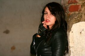 beauty of the rock brunette in a black leather jacket