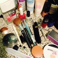 brushes, powder and cosmetics on the table
