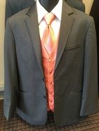 men's suit with a pink tie
