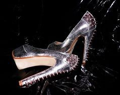 silver high heeled shoes