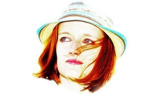 red haired woman in panama hat