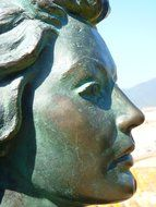 woman face profile, bronze statue