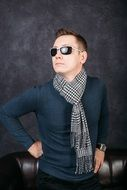 stylish man in sunglasses and scarf