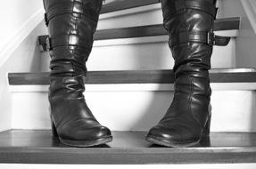 Black woman's boots are on the stairs