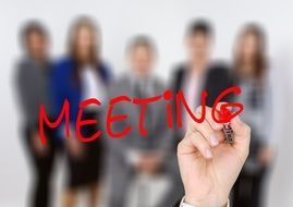 Clipart of meeting sign at the background of people