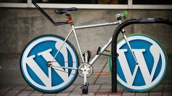 Bicycle with wordpress logo on the wheels