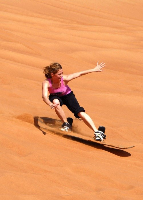 Photo of Girl sandboarding