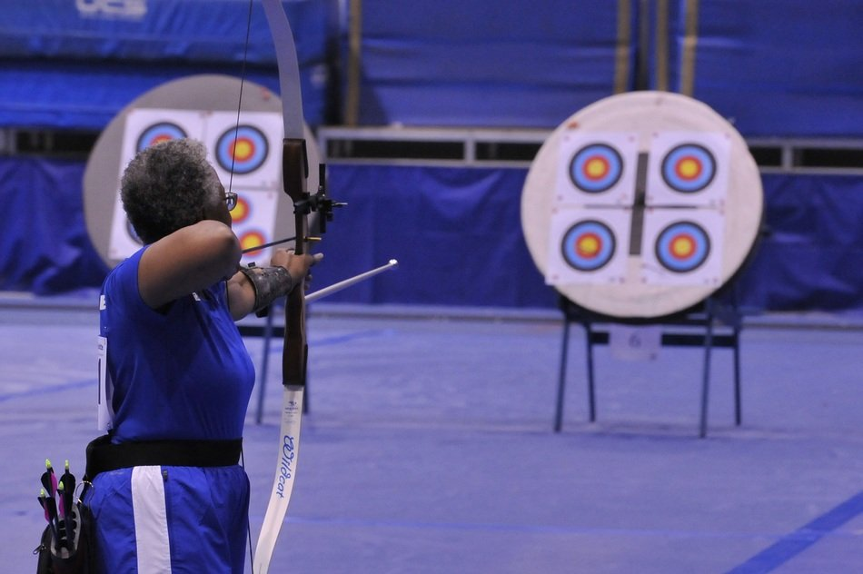 woman with a bow in front of targets
