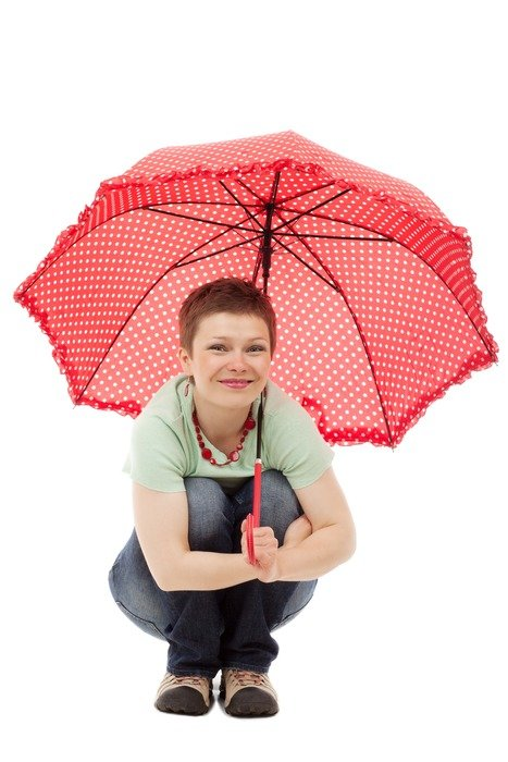 woman with an umbrella squatting