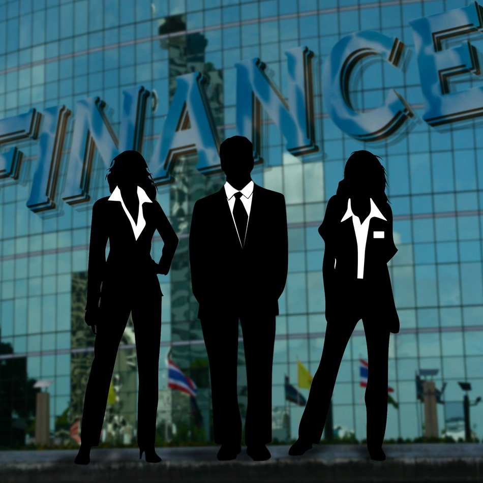 silhouette of a team of businessmen on the background of the inscription finance