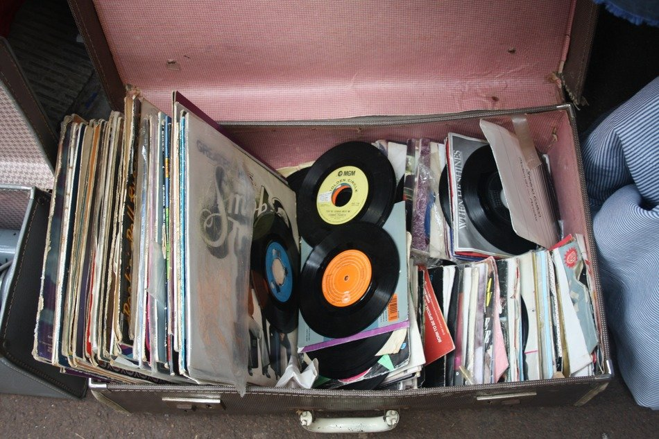 records in a large suitcase as antiques
