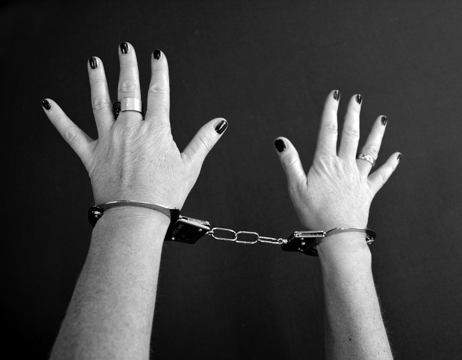 woman's hands with handcuffs