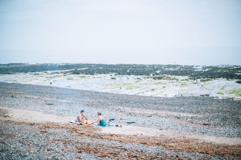 people on the beach among algae