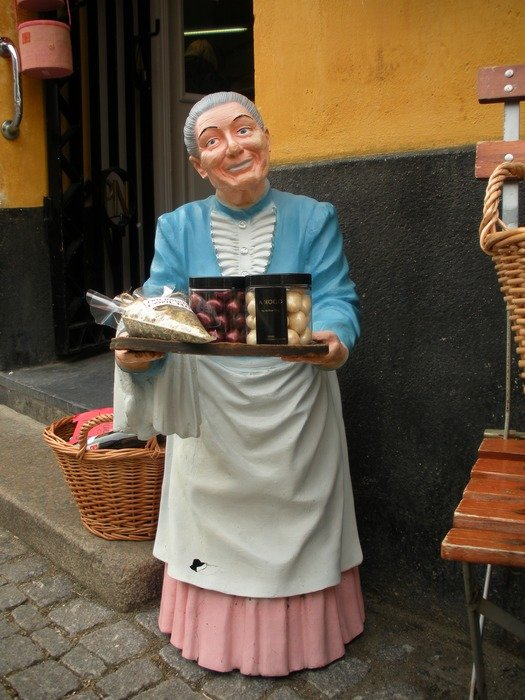 statue of an old woman as a decoration of the store