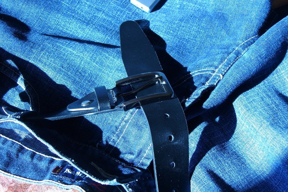 black leather belts and jeans
