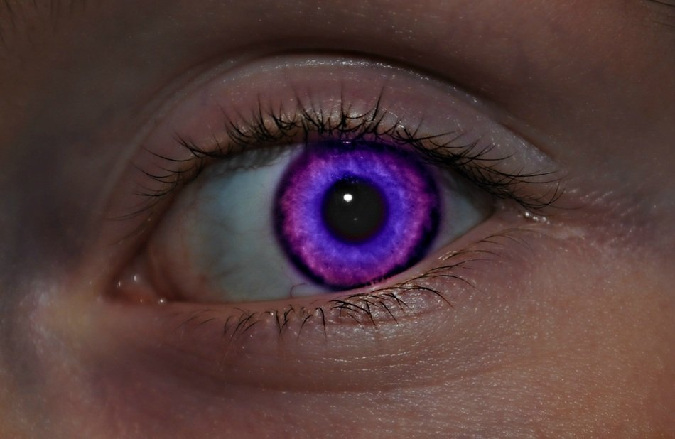 woman with bright purple eye close up
