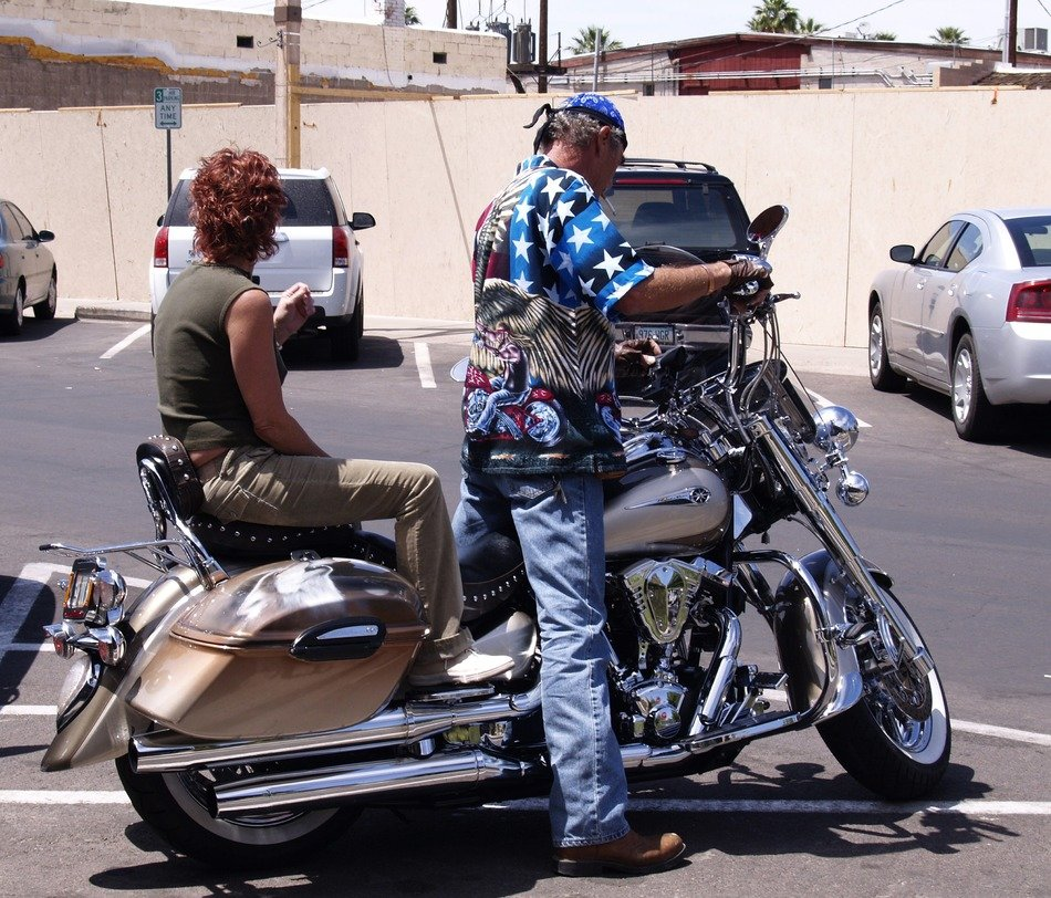 man with woman on a motorcycle harley davidson