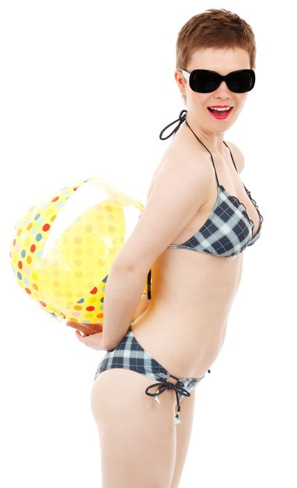 Girl in bikini with short hair and a beach ball