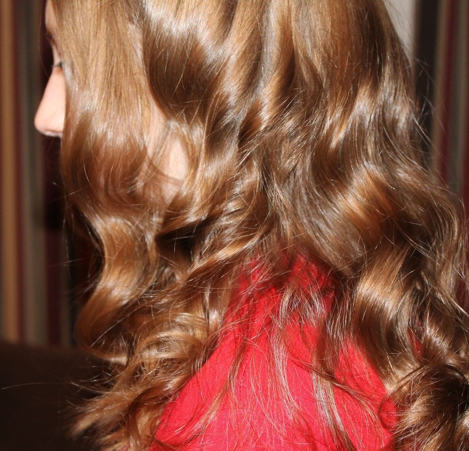girl with long wavy curls