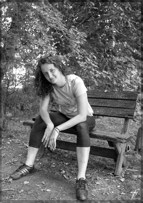 black and white photo bench female woman