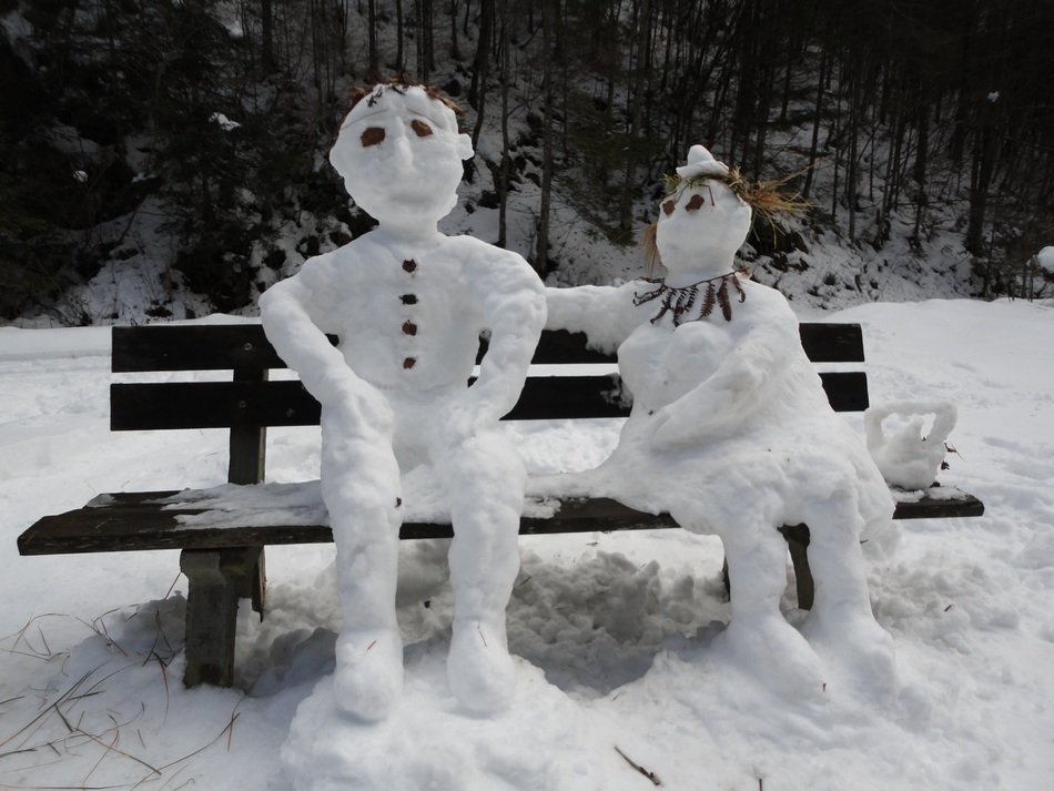 snow figures on the bench