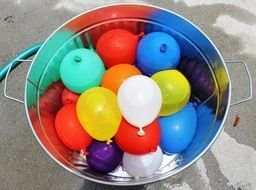 colorful Balloons filled with water in bucket