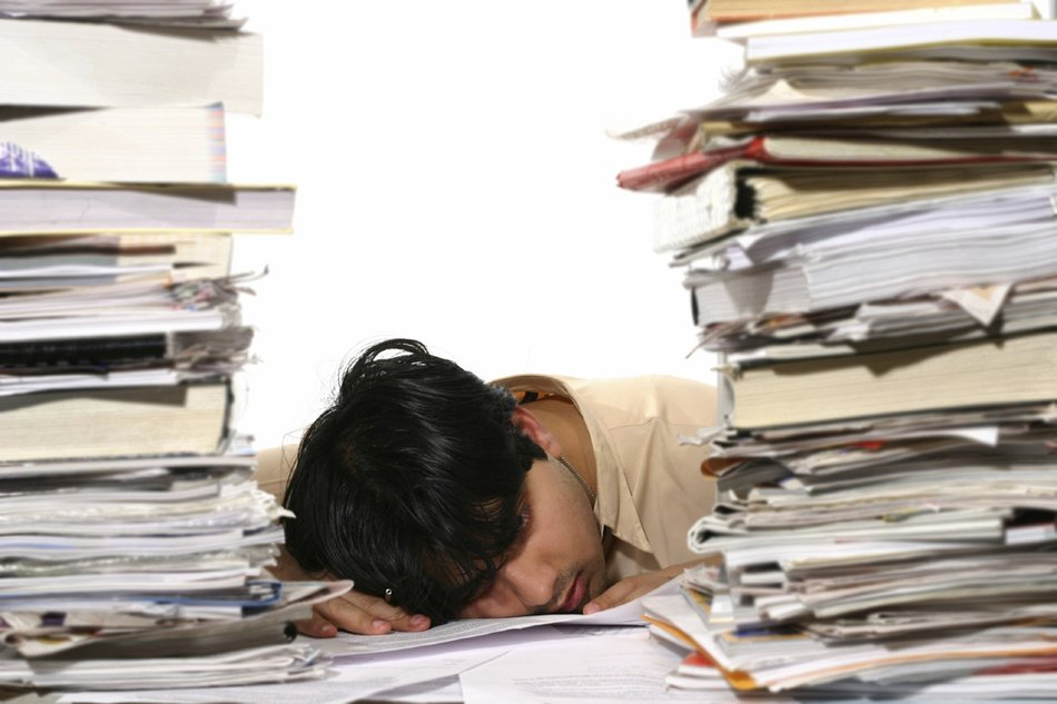 asian man sleeps on desk at piles of documents, Too Much Work