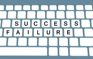 success and failure words on keyboard, challenge concept
