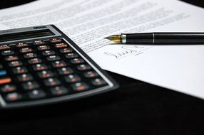 calculator and documents with pen