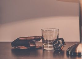 glass, wallet and watch