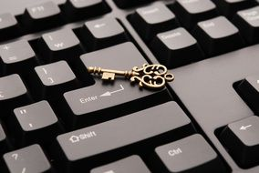keyboard and gold key