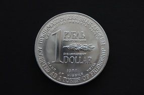 a silver ruble and dollar coin