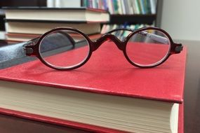 spectacles on the red book