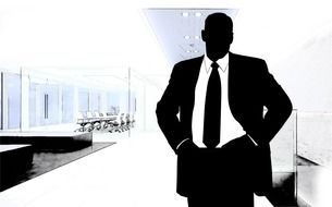 silhouette of businessman on the background of buildings