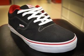 black sneakers with red details