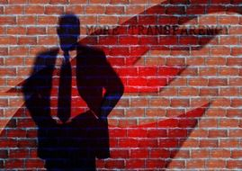 transparent silhouette of a businessman on the background of a brick wall