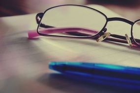 glasses and notepad and pen