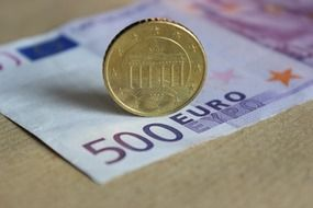 gold coin on a banknote of 500 euros