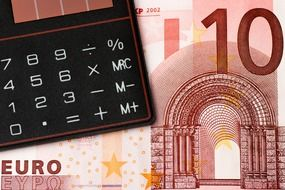 10 euro banknote and calculator