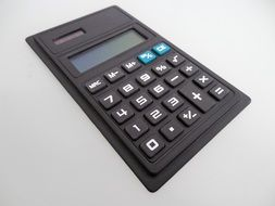 black calculator on a white background