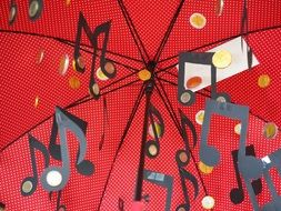 Paper notes on a background of red umbrella