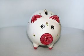 ceramic piggy bank as a pig with red spots