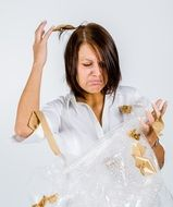 frustration on the face of a woman working with packaging and adhesive tape