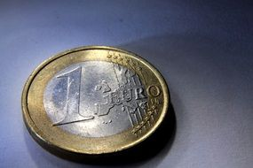 Euro coin on a gray background