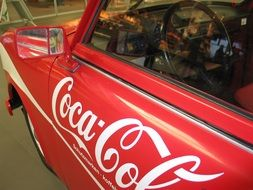 Coca Cola label on car door