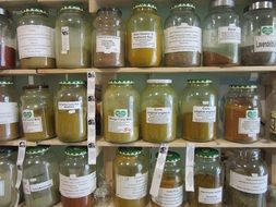 spices in transparent jars on the shelf